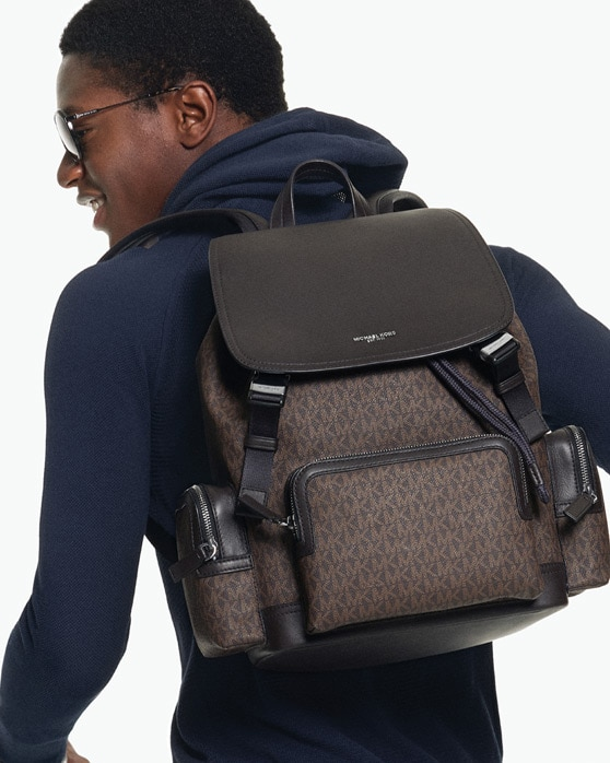 e5b1c773 For men on the move: a stylish backpack to carry your day, with roomy  compartments for easy organization.